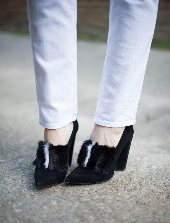 Fendi fur-paneled pumps, AG The Prima white jeans