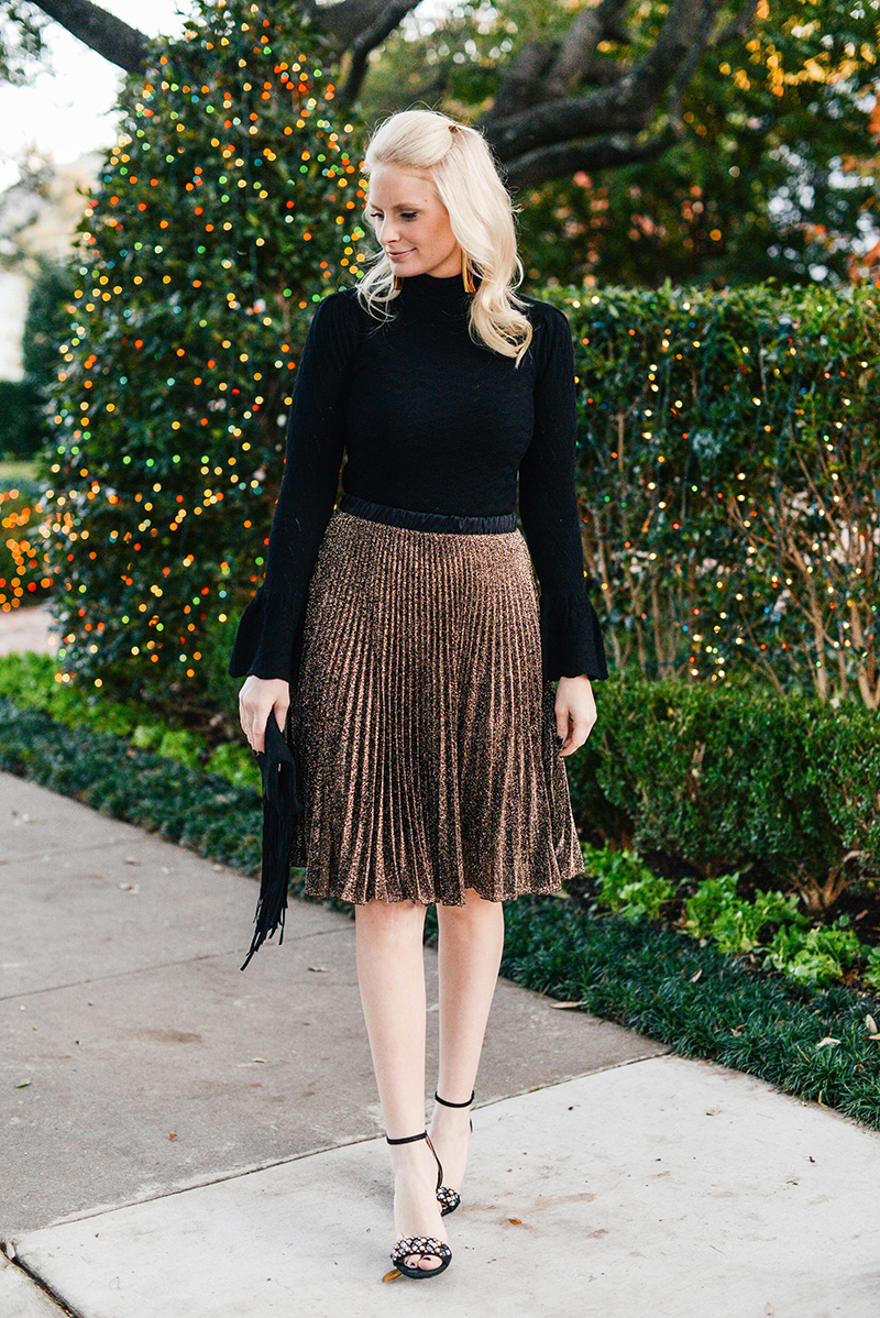 bell sleeve black sweater metallic pleated skirt