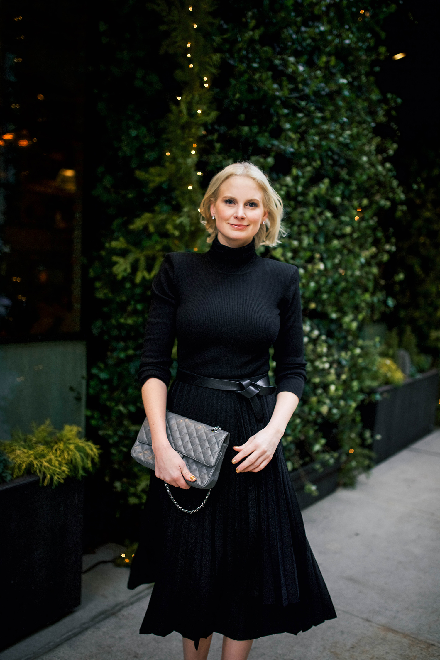 Merritt Beck, Dallas Style Blogger in Black Pleated Midi Skirt