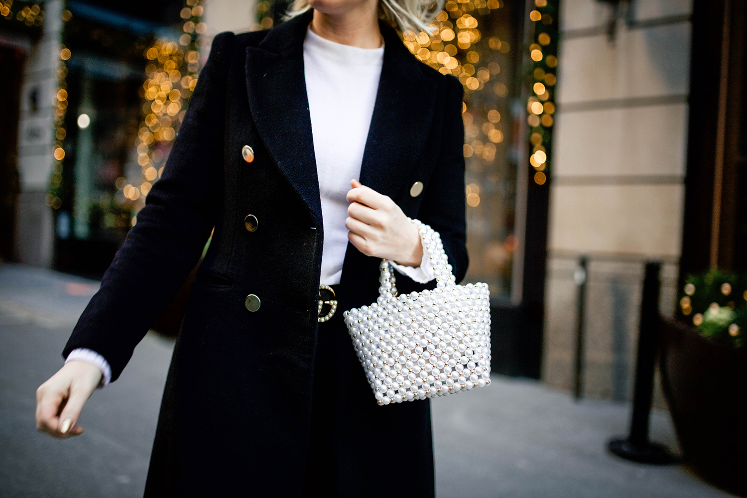 Merritt Beck wearing Club Monaco's Black Jemma Coat in New York