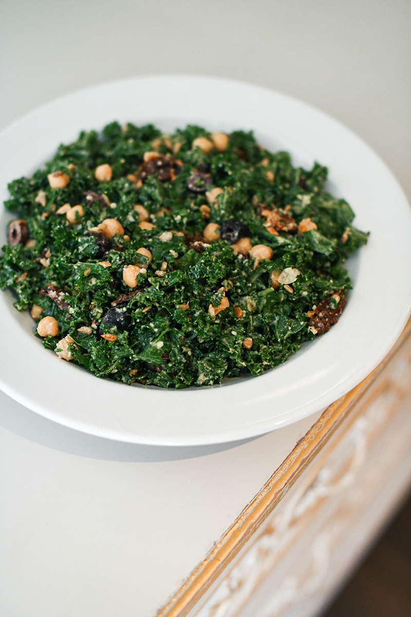 Greek Kale Salad, featuring chickpeas, olives, and a creamy tahini dressing!